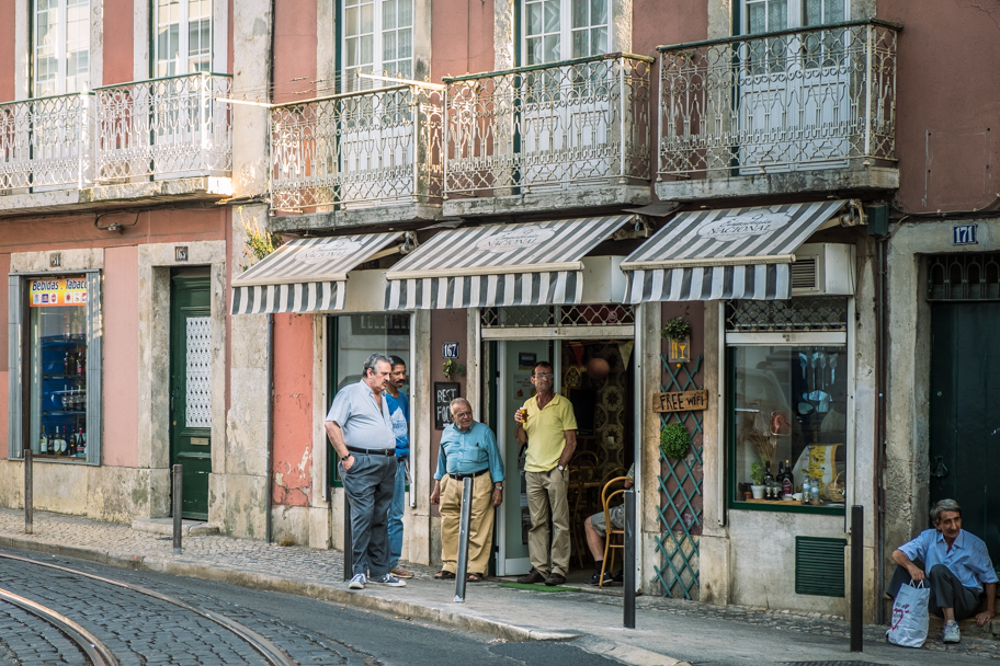 Portuguese Men Gather on the Street, Lisbon, Portugal | Barbara Cameron | Food & Travel Photographer