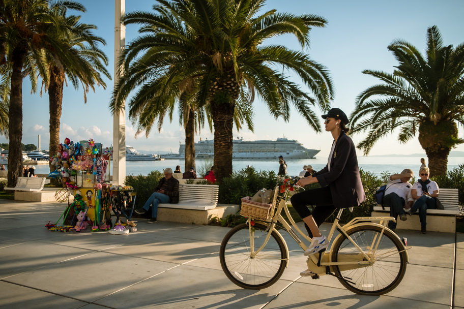 Woman on Bike, The Riva, Split, Croatia | Barbara Cameron | Food & Travel Photographer