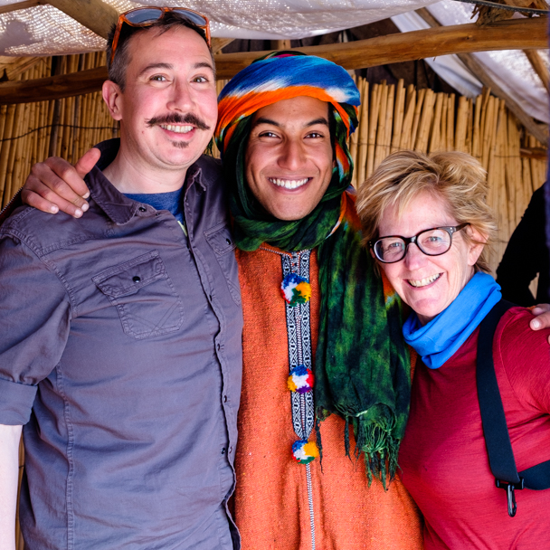 Berber guide welcomes tourists for their camel trek in Morocco | Barbara Cameron Pix | Food & Travel Photographer