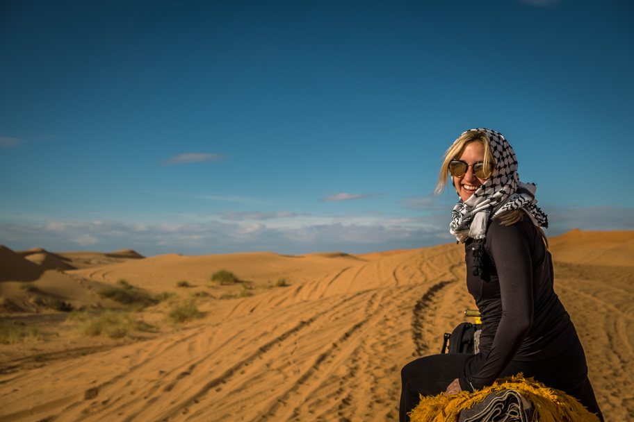 Female tourist on a camel trek in the Sahara Desert, Morocco | Barbara Cameron Pix | Food & Travel Photographer