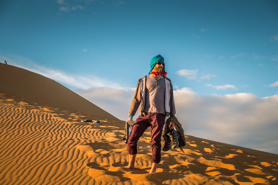 Male tourist on a sand dune, Sahara Desert, Morocco | Barbara Cameron Pix | Food & Travel Photographer