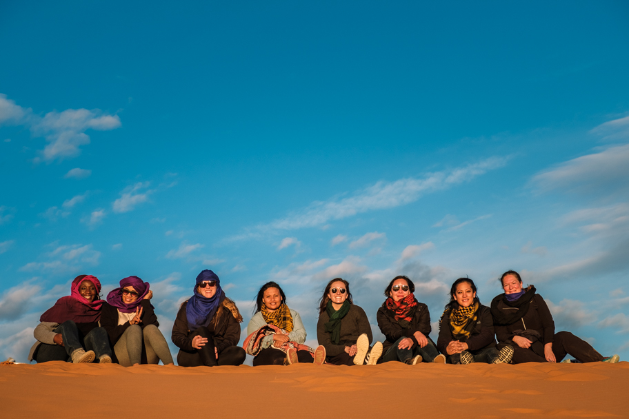 Female tourists on a sand dune, Sahara Desert, Morocco | Barbara Cameron Pix | Food & Travel Photographer