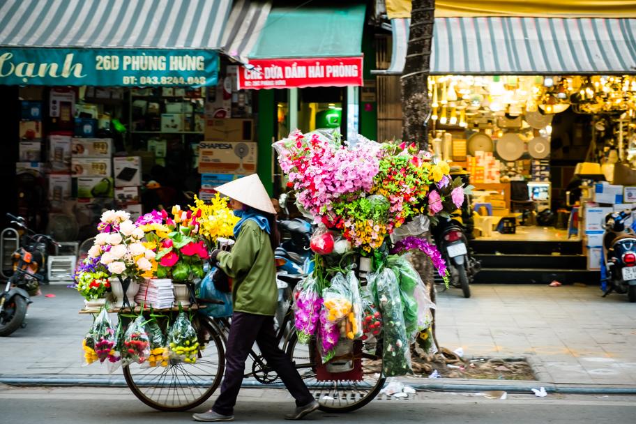 Mobile flower vendor on bicycle, Hanoi, Vietnam | Barbara Cameron Pix | Food & Travel Photographer