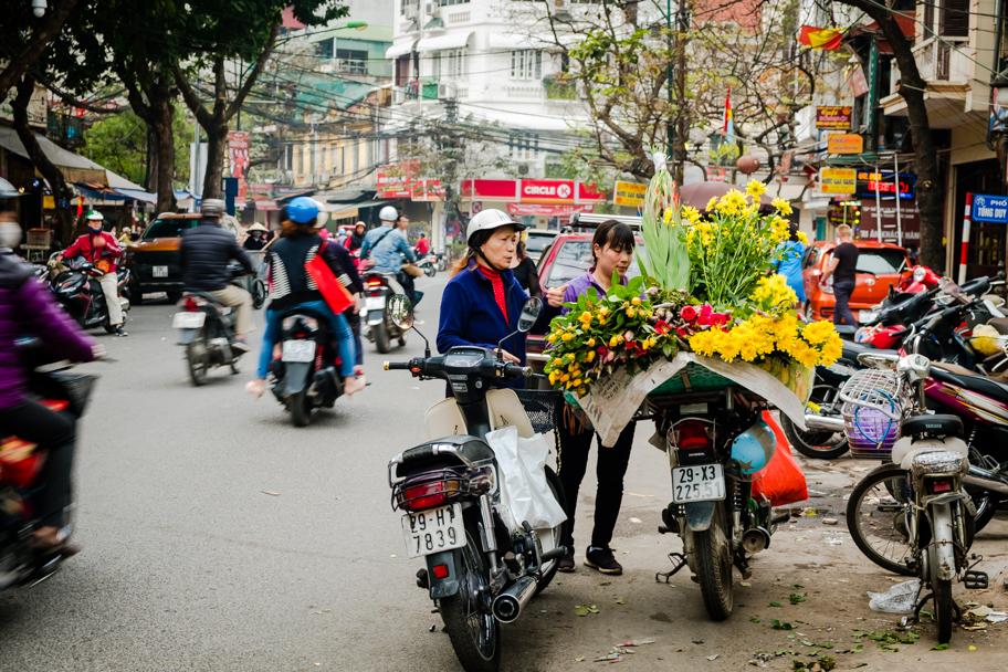 Mobile flower vendor on scooter, Hanoi, Vietnam | Barbara Cameron Pix | Food & Travel Photographer