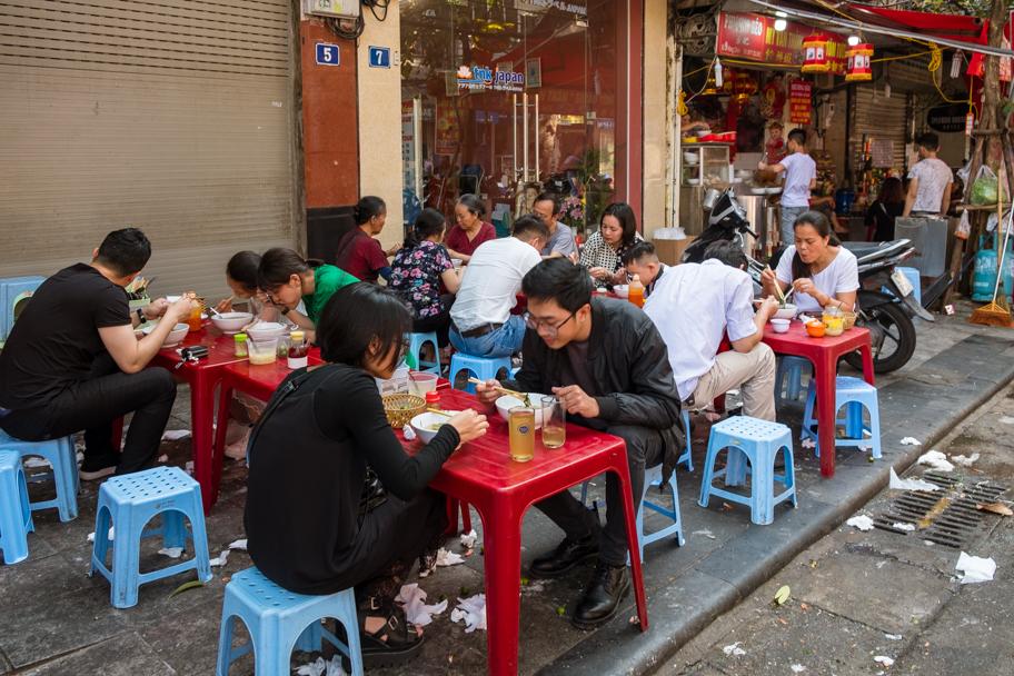 Outdoor restaurant tables & stools, Hanoi, Vietnam | Barbara Cameron Pix | Food & Travel Photographer