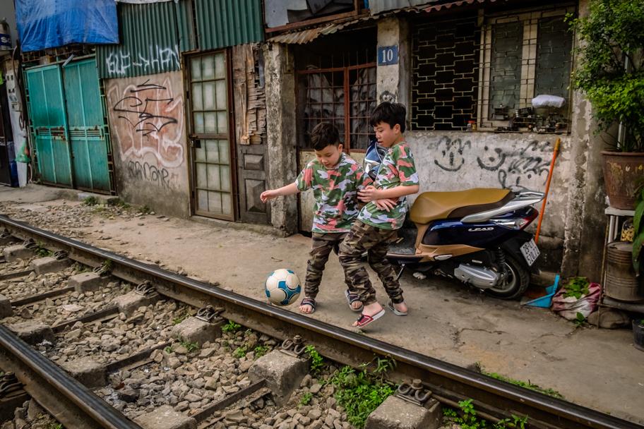 Local boys play soccer on Train Street, Hanoi, Vietnam | Barbara Cameron Pix | Food & Travel Photographer