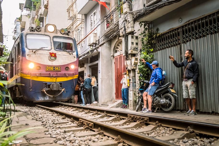 Tourists flock to train street, Hanoi, Vietnam | Barbara Cameron Pix | Food & Travel Photographer