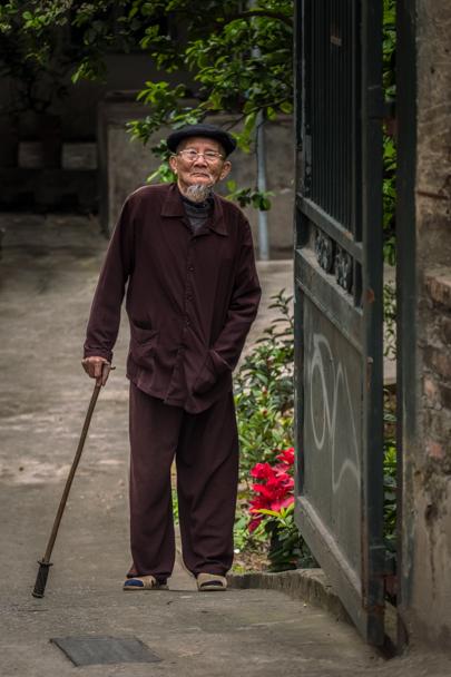 Older gentleman walking with cane, Hanoi, Vietnam | Barbara Cameron Pix | Food & Travel Photographer