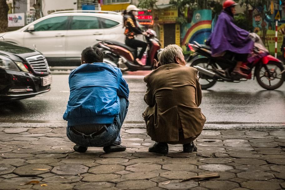 Vietnamese men squat roadside, Hanoi, Vietnam | Barbara Cameron Pix | Food & Travel Photographer