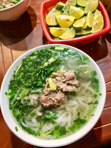 A full bowl of beef pho in Hanoi, Vietnam. Photo by Barbara Cameron Pix, Food & Travel Photographer