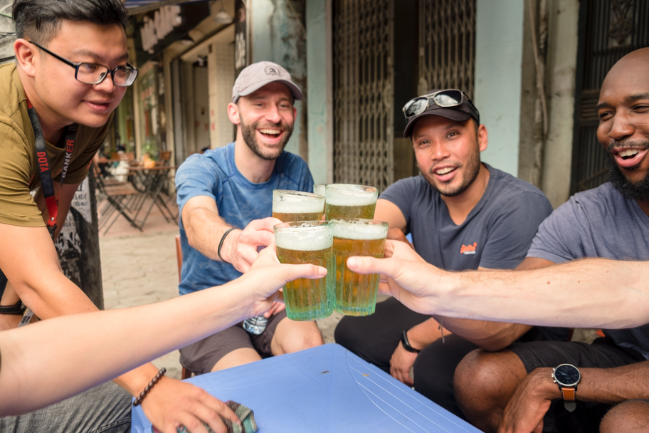Friends cheer with fresh beer in Hanoi, Vietnam | Barbara Cameron Pix | Food & Travel Photographer