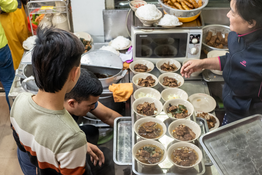 Many bowls of bun cha lined up in a restaurant in Hanoi, Vietnam. Photo by Barbara Cameron Pix, Food & Travel Photographer