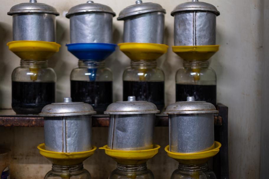 Coffee filters at Cafe Dinh, Hanoi, Vietnam | Barbara Cameron Pix | Food & Travel Photographer