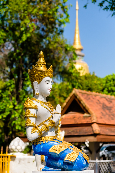 Buddhist statue on the grounds of Wat Suan Dok, Chiang Mai, Thailand | Barbara Cameron Pix | Food & Travel Photographer