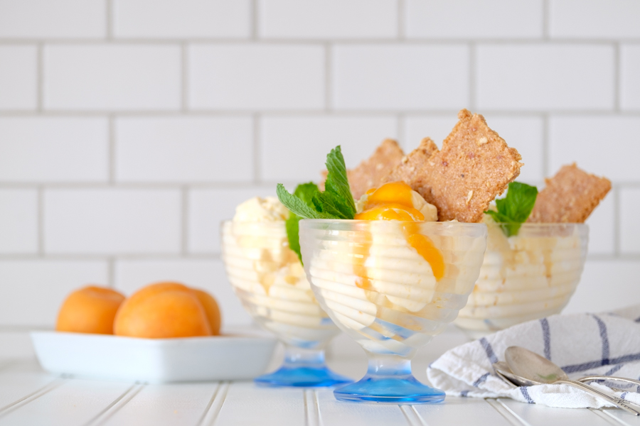 three cups of apricot ice cream with mint and graham crackers